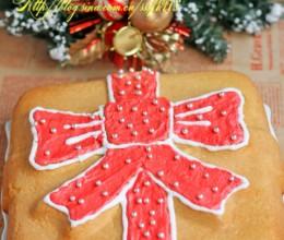可爱的圣诞款蝴蝶结蛋糕吐血的色素和霜糖